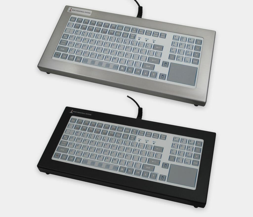 Claviers industriels pour plan de travail course courte avec dispositif de pointage sur pavé tactile, conformes IP65/IP66
