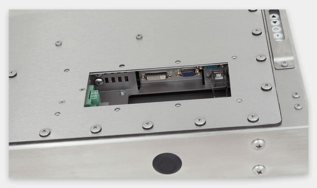"""Écrans 19"""" à montage encastrable universel pour usage industriel et écrans tactiles robustes homologués IP65/IP66, vue sortie câble CC"""